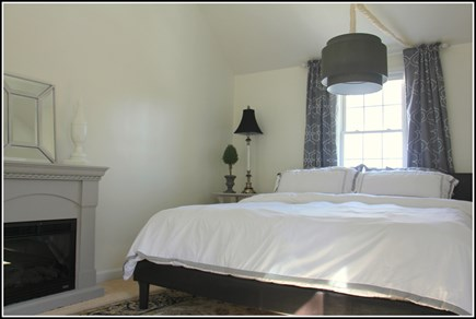 Plymouth MA vacation rental - Luxury master bedroom with a fireplace