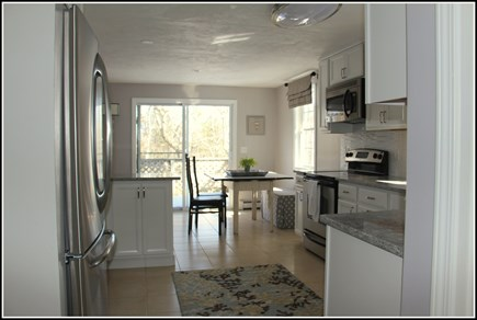 Plymouth MA vacation rental - Eat-in kitchen w sliders to a private deck surrounded by trees