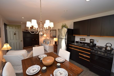 Orleans Cape Cod vacation rental - Carriage House living/dining/kitchen with sliders to private deck
