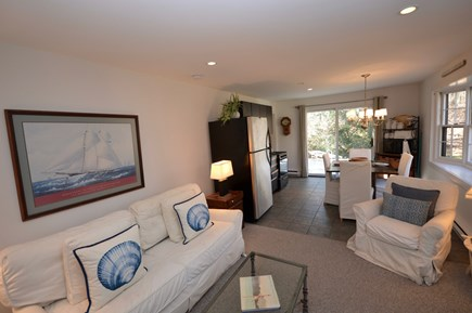Orleans Cape Cod vacation rental - Carriage House living room with queen sleeper sofa, fireplace, TV