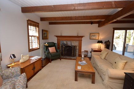 Orleans Cape Cod vacation rental - Living room in the main house with fireplace, queen sleeper sofa
