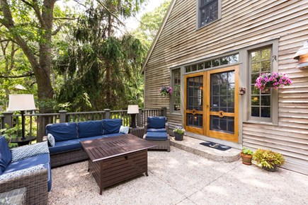 Orleans Cape Cod vacation rental - Back deck off the Main House leading out towards the pool