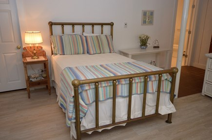 Orleans Cape Cod vacation rental - Main House lower level suite with full bed and wood stove