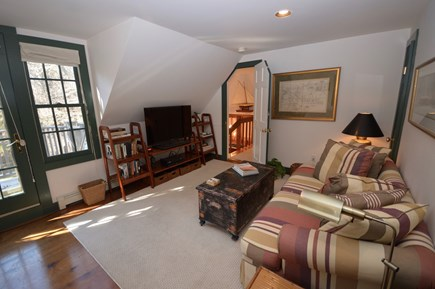 Orleans Cape Cod vacation rental - Main House Master sitting area with large flat screen TV
