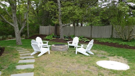 Chatham Cape Cod vacation rental - A backyard oasis.  Perfect for summer nights around the fire pit.