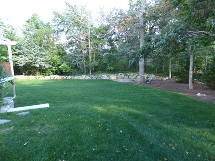 Dennis Cape Cod vacation rental - Large Back yard with a fire pit & large new outside shower