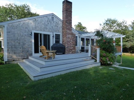 Dennis Cape Cod vacation rental - Side of house with new deck and Large back yard
