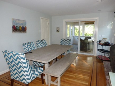 Dennis Cape Cod vacation rental - Dining area next to kitchen with a fireplace and slider to outsid