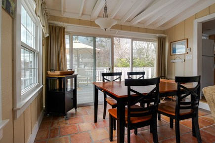 Barnstable Cape Cod vacation rental - Enjoy meals together at the dining room table in the sunroom