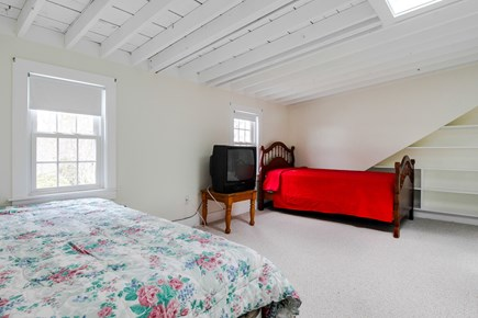 Barnstable Cape Cod vacation rental - Open bedroom on upper level with a queen bed and 3 twins