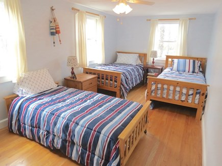 Brewster Cape Cod vacation rental - Second level bedroom with three twins.