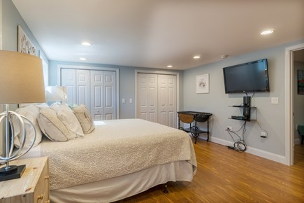 Dennis Cape Cod vacation rental - Master bedroom features a king bed and flat screen TV