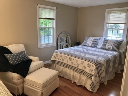 South Yarmouth Cape Cod vacation rental - Queen Bedroom w/ rocker/glider and wicker furniture.