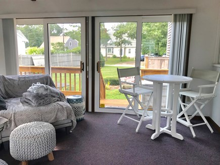 South Yarmouth Cape Cod vacation rental - Sun Splashed SunRoom w/cathedral ceilings & wall mounted TV.