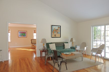 Harwich Port Cape Cod vacation rental - Living area with slider leading to deck & private back yard