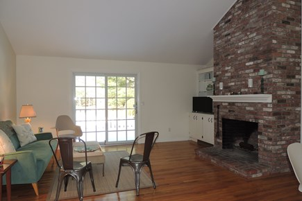 Harwich Port Cape Cod vacation rental - Fire placed living room opens to the kitchen
