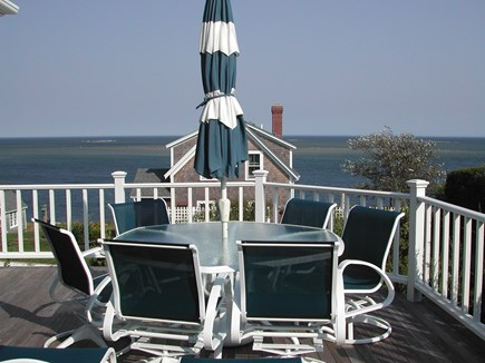 Chatham Cape Cod vacation rental - Dining set on the expansive deck overlooking the Atlantic.