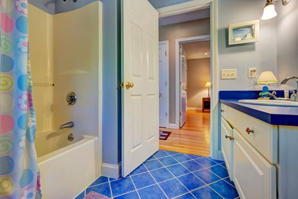 Eastham Cape Cod vacation rental - A shared full bathroom includes a tub, shower, and storage