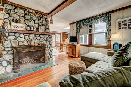Falmouth Cape Cod vacation rental - Relax in the homey living room featuring a wood-burning fireplace