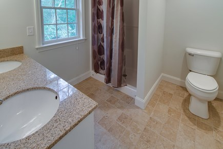 Harwich Cape Cod vacation rental - A full bathroom with a shower has plenty of room to freshen up