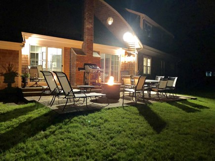 Osterville Osterville vacation rental - Fenced off backyard w patio, grill, table & chairs & fire pit.