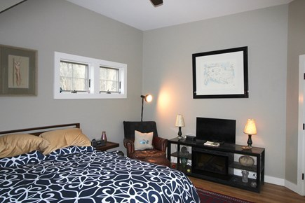 Provincetown Cape Cod vacation rental - Main Bedroom with Queen Bed, Flat Screen TV above gas fireplace