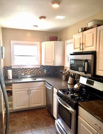 Provincetown Cape Cod vacation rental - Renovated Kitchen with Stainless steel appliances.
