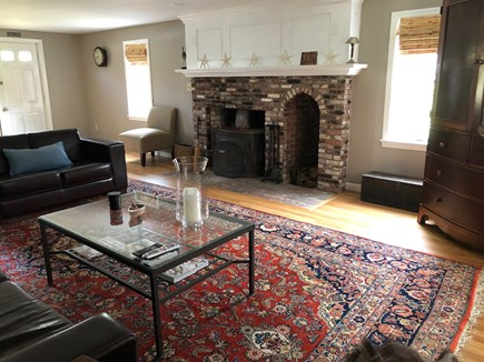Eastham Cape Cod vacation rental - Living room fireplace
