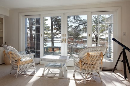 Mashpee Cape Cod vacation rental - Living room with access to the deck and water views