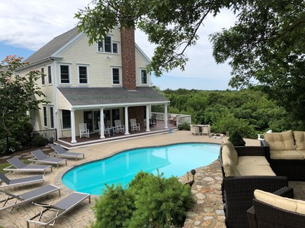 West Barnstable Cape Cod vacation rental - View of the home and pool from the driveway from the upper patio.
