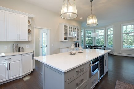 West Barnstable Cape Cod vacation rental - Open Floor plan, Wine Cooler, Large Island and Quartz Counters.