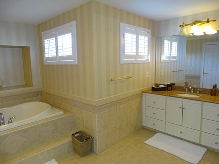 Mashpee Cape Cod vacation rental - Master bathroom with tub, double sink, walk in shower