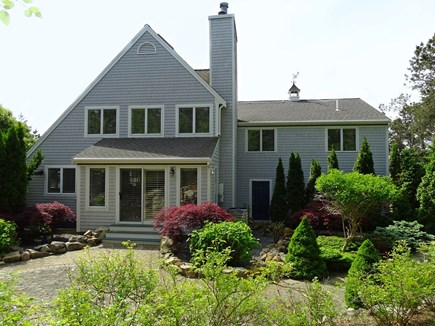 Mashpee Cape Cod vacation rental - View of back of house, outdoor shower, patio, gardens