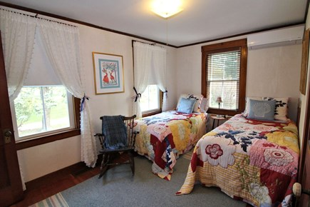 North Truro Cape Cod vacation rental - First floor bedroom with two twins and ductless split unit A/C.
