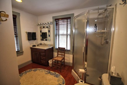 North Truro Cape Cod vacation rental - First floor bathroom with shower stall and washer/dryer.