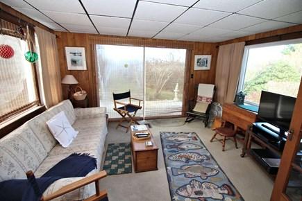 North Truro Cape Cod vacation rental - Cozy sun room with satellite television.
