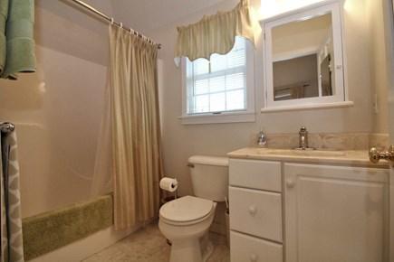 North Truro Cape Cod vacation rental - Full bathroom with tub/shower in studio over garage.