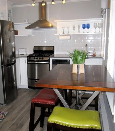 Provincetown Cape Cod vacation rental - Kitchen with counter height table with seating for four.