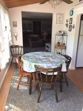 Brewster Cape Cod vacation rental - Dining room with ceiling fan and slider that opens onto the deck