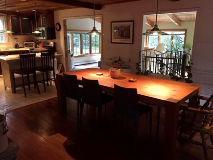 East Dennis Cape Cod vacation rental - Sun room with TV beyond dining area, spiral stairs down to pool