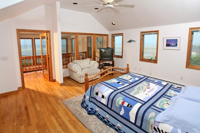Eastham Cape Cod vacation rental - Master Bedroom suite with glass wall on upper level