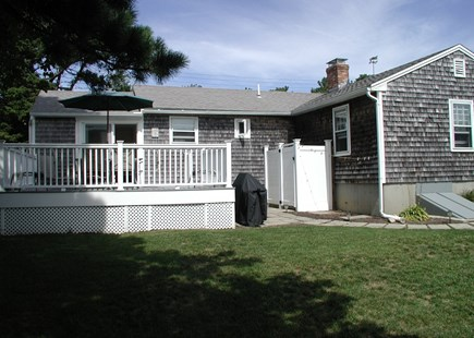 Sandwich Cape Cod vacation rental - Back deck with seating, grill and steps down to outdoor shower.