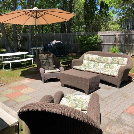 West Dennis Cape Cod vacation rental - Relax on this comfy patio - outdoor shower, picnic table & grill