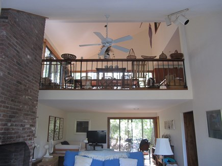 Wellfleet Cape Cod vacation rental - The downstairs living room looks up at the dining room.