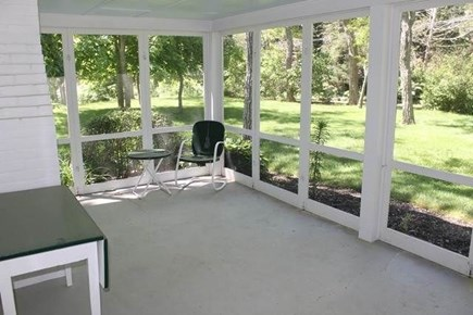 Brewster Cape Cod vacation rental - Screened in porch with views of well maintained property