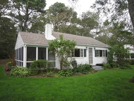 Brewster Cape Cod vacation rental - Main view of cottage and screened in porch, take a seat enjoy