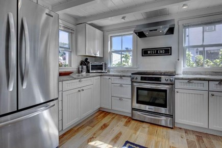 Provincetown Cape Cod vacation rental - The Fridge Makes Ice, The Windows Look  Out Onto Commercial St.