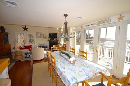 Orleans Cape Cod vacation rental - Open dining area with water views and sliders to the deck