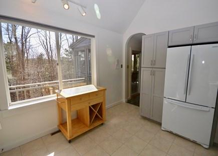 Wellfleet Cape Cod vacation rental - Open kitchen with door to back deck area