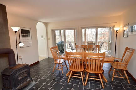 Wellfleet Cape Cod vacation rental - Dining room with sliders to screened porch with outdoor dining